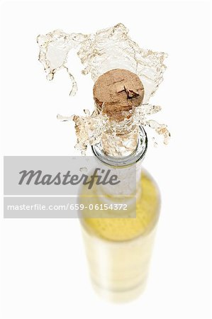 White wine spraying out of a bottle Stock Photo - Premium Royalty-Free, Image code: 659-06154372