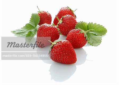 Strawberries with leaves Stock Photo - Premium Royalty-Free, Image code: 659-06154855