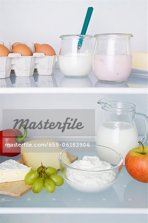 A fridge filled with dairy products, eggs, fruit and vegetables Stock Photo - Premium Royalty-Free, Image code: 659-06183906