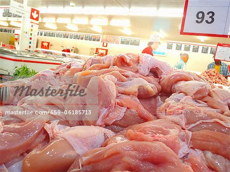 A pile of fresh chicken breast in a supermarket in Thailand Stock Photo - Premium Royalty-Free, Image code: 659-06185713