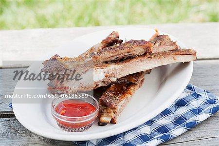 Grilled spare ribs and barbecue sauce Stock Photo - Premium Royalty-Free, Image code: 659-06186389