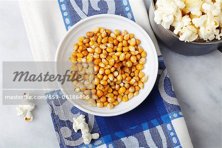 Corn kernels and popcorn Stock Photo - Premium Royalty-Free, Image code: 659-06186496