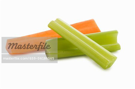 Two Celery Sticks and a Carrot Stick on a White Background Stock Photo - Premium Royalty-Free, Image code: 659-06186565