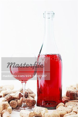 A bottle and a glass of wine and corks Stock Photo - Premium Royalty-Free, Image code: 659-06187187