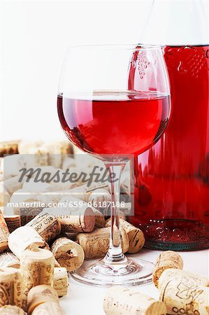 A bottle and a glass of wine and corks Stock Photo - Premium Royalty-Free, Image code: 659-06187188