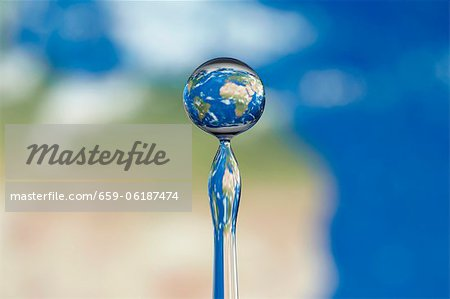 Globe in a water drop Stock Photo - Premium Royalty-Free, Image code: 659-06187474