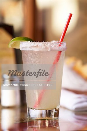 Margarita in a Glass with a Salted Rim and a Red Straw Stock Photo - Premium Royalty-Free, Image code: 659-06188196