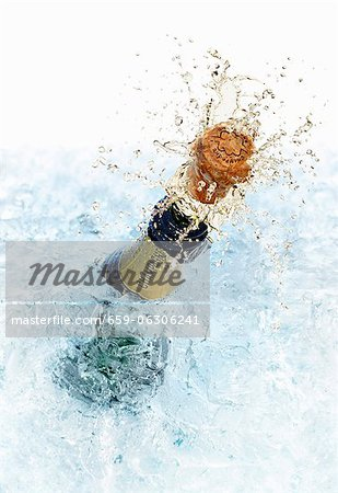 An open champagne bottle Stock Photo - Premium Royalty-Free, Image code: 659-06306241