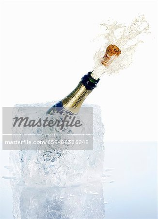 An open champagne bottle Stock Photo - Premium Royalty-Free, Image code: 659-06306242