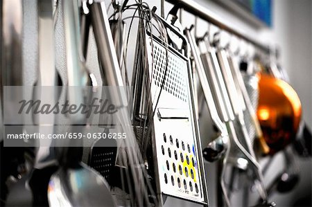 Various kitchen utensils hanging on a wall Stock Photo - Premium Royalty-Free, Image code: 659-06306255