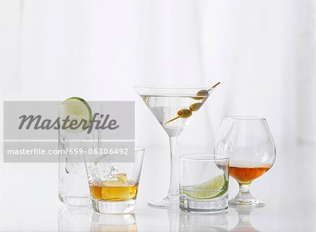 Five Assorted Glasses with Assorted Liquors Stock Photo - Premium Royalty-Free, Image code: 659-06306492