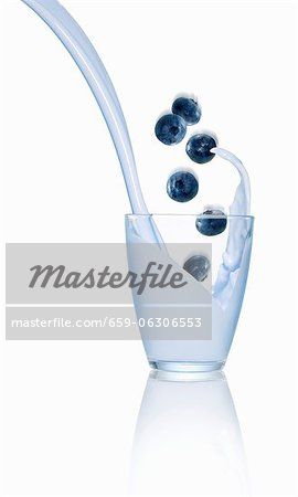 Blueberries falling into a glass of milk Stock Photo - Premium Royalty-Free, Image code: 659-06306553