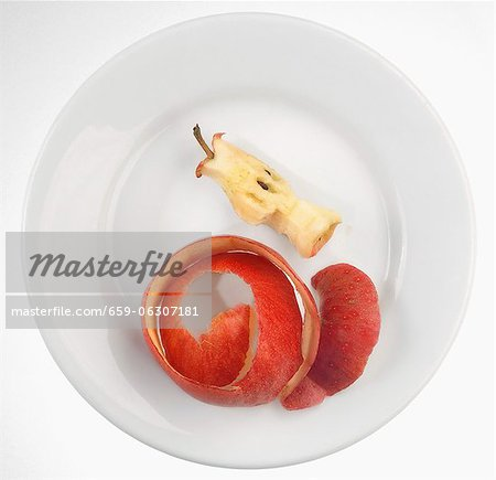 An apple core and apple peel on a plate Stock Photo - Premium Royalty-Free, Image code: 659-06307181