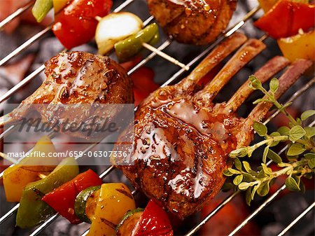 Vegetable kebabs and ribs on a barbecue Stock Photo - Premium Royalty-Free, Image code: 659-06307336