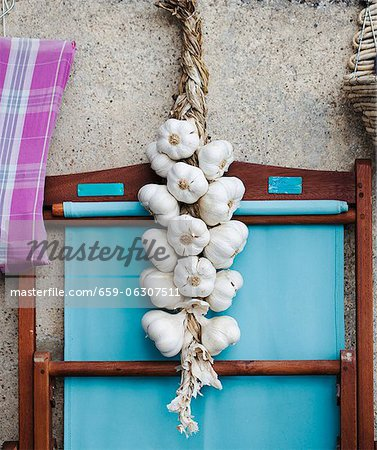 A rope of garlic Stock Photo - Premium Royalty-Free, Image code: 659-06307511