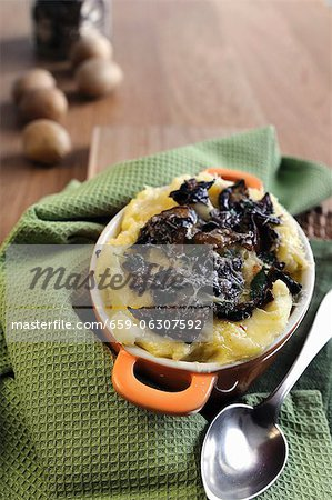 Mashed potatoes with dried porcini mushrooms, fontina and Parmesan Stock Photo - Premium Royalty-Free, Image code: 659-06307592