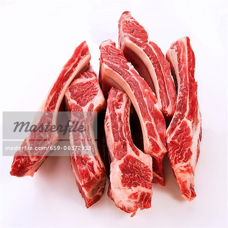Raw Beef Ribs on a White Background Stock Photo - Premium Royalty-Free, Image code: 659-06372933