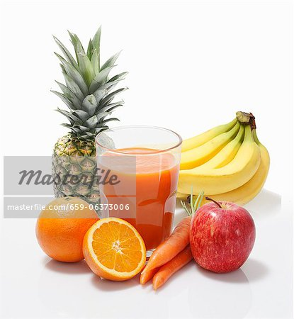 Multi-vitamin juice surrounded by whole fruits Stock Photo - Premium Royalty-Free, Image code: 659-06373006