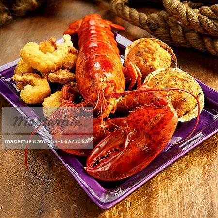 Seafood Platter with Lobster, Fried Shrimp and Stuffed Clams Stock Photo - Premium Royalty-Free, Image code: 659-06373063