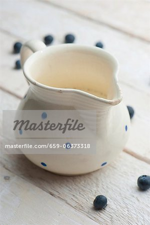 A jug of milk with blueberries Stock Photo - Premium Royalty-Free, Image code: 659-06373318