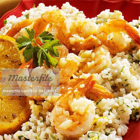 Garlic Sauteed Shrimp on Orange Infused Rice Stock Photo - Premium Royalty-Free, Image code: 659-06373395