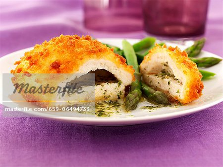 Chicken kiev with garlic butter, herbs and asparagus Stock Photo - Premium Royalty-Free, Image code: 659-06494733