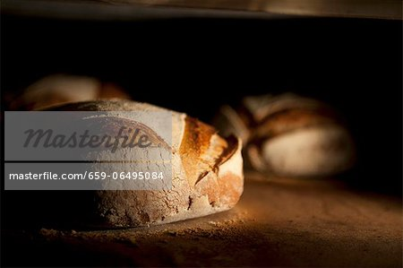 Bread in an oven Stock Photo - Premium Royalty-Free, Image code: 659-06495084