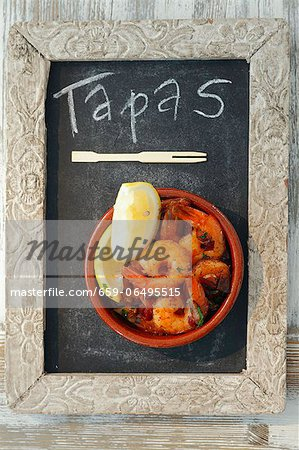 Gambas al ajillo (garlic prawns, Spain) Stock Photo - Premium Royalty-Free, Image code: 659-06495515