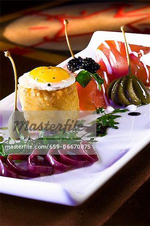 Salmon with a Quail Egg, Roe, Caper Berries and Balsamic Dressing Stock Photo - Premium Royalty-Free, Image code: 659-06670875