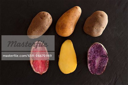 Various different types of potatoes on a slate surface Stock Photo - Premium Royalty-Free, Image code: 659-06670949