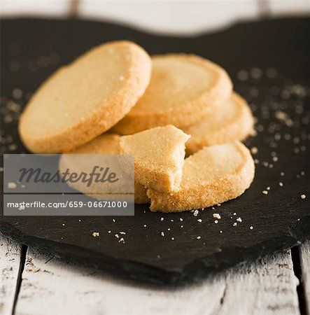 Shortbread biscuits on a slate surface Stock Photo - Premium Royalty-Free, Image code: 659-06671000