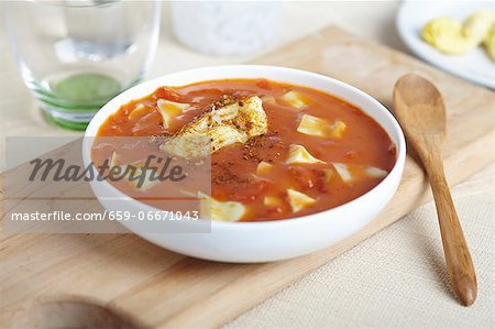 Bowl of Tomato Artichoke Soup; Wooden Spoon Stock Photo - Premium Royalty-Free, Image code: 659-06671043