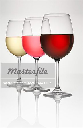 Three wine glasses (of white, rosÈ, and red wine) Stock Photo - Premium Royalty-Free, Image code: 659-06671367