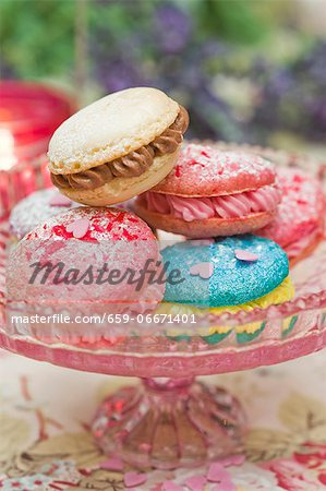 Macaroons filled with buttercream on a cake stand Stock Photo - Premium Royalty-Free, Image code: 659-06671401