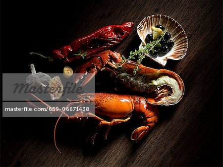 A still life including lobster, olives and thyme Stock Photo - Premium Royalty-Free, Image code: 659-06671438