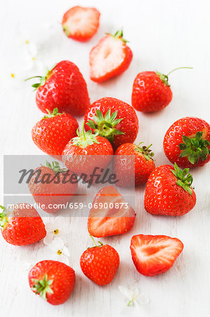 Strawberries, whole and halved Stock Photo - Premium Royalty-Free, Image code: 659-06900873