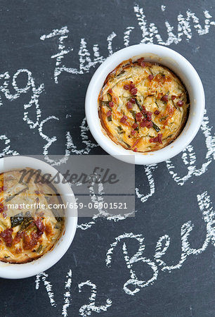 Two Individual Zucchini Casseroles on Chalkboard Surface Stock Photo - Premium Royalty-Free, Image code: 659-06901521