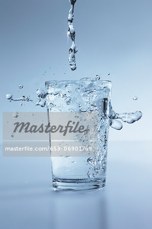 Water splashing out of a glass Stock Photo - Premium Royalty-Free, Image code: 659-06901769