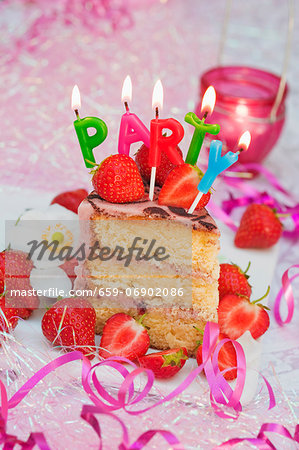 A piece of strawberry layer cake with candles, for a birthday Stock Photo - Premium Royalty-Free, Image code: 659-06902086