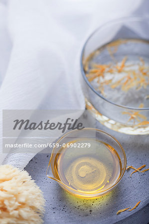 Marigold oil and sponge Stock Photo - Premium Royalty-Free, Image code: 659-06902279