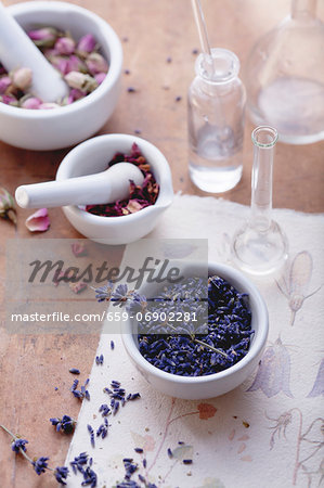 Rose and lavender flowers with mortar and apothecary bottles Stock Photo - Premium Royalty-Free, Image code: 659-06902281