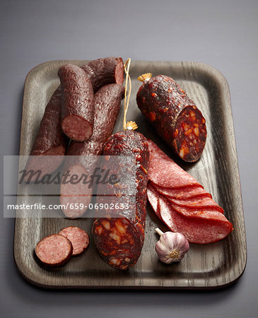 Assorted sausages and salamis on a tray Stock Photo - Premium Royalty-Free, Image code: 659-06902633