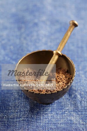 Allspice in a mortar (ground) Stock Photo - Premium Royalty-Free, Image code: 659-06902813