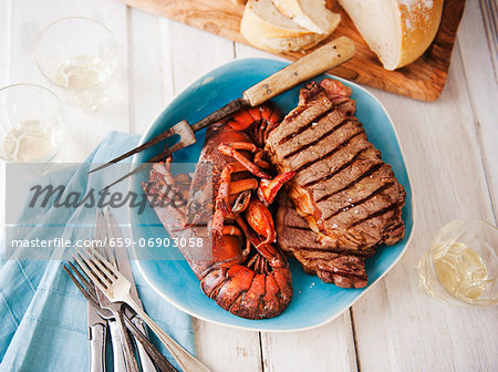 Surf and Turf Platter with Grilled Steak and Lobster; With Bread; From Above Stock Photo - Premium Royalty-Free, Image code: 659-06903058