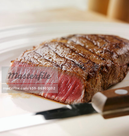 A rare sirloin steak Stock Photo - Premium Royalty-Free, Image code: 659-06903102