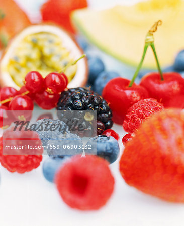 Close up of a selection of fresh fruits including blueberries, redcurrants, passion fruit, raspberries, blackberries, strawberries and cherries. Stock Photo - Premium Royalty-Free, Image code: 659-06903132
