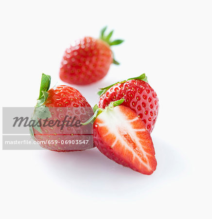 Strawberries, whole and halved Stock Photo - Premium Royalty-Free, Image code: 659-06903547