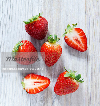 Strawberries on a wooden slab, viewed from above Stock Photo - Premium Royalty-Free, Image code: 659-06903548