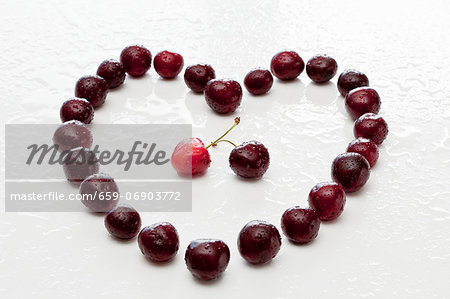 A heart made from cherries Stock Photo - Premium Royalty-Free, Image code: 659-06903772