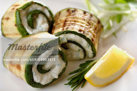 Grilled zucchini rolled up with ricotta - herb paste Stock Photo - Premium Royalty-Free, Image code: 659-06903973